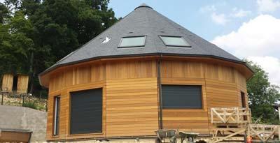 instalacion de canalones de aluminio en vivienda de madera